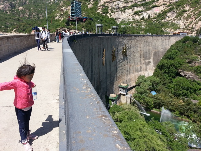 A young girl at the dam