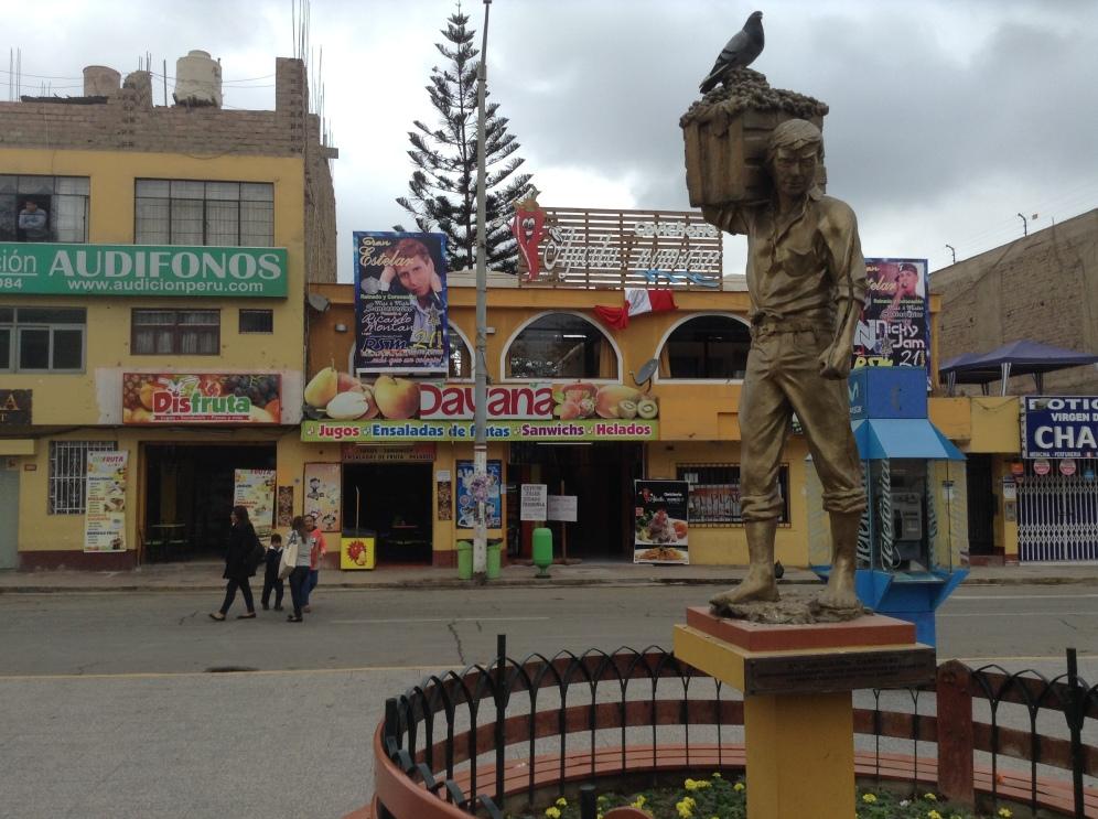 a statue of an Afro-Peruvian farmer