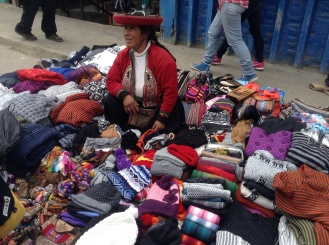 a woman sells her wares in the street market